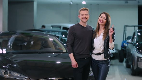 Thumbnail for Happy Couple Buy a Electric Car