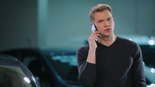 Cover Image for Man Talking On The Phone In The Car's Salon