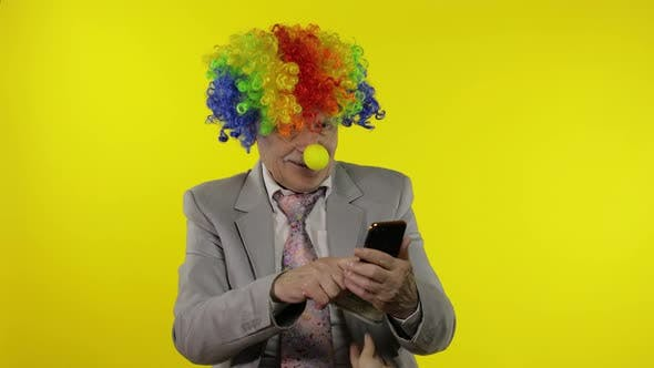 Thumbnail for Clown Businessman Freelancer Loses Money While Playing on Phone Online Games
