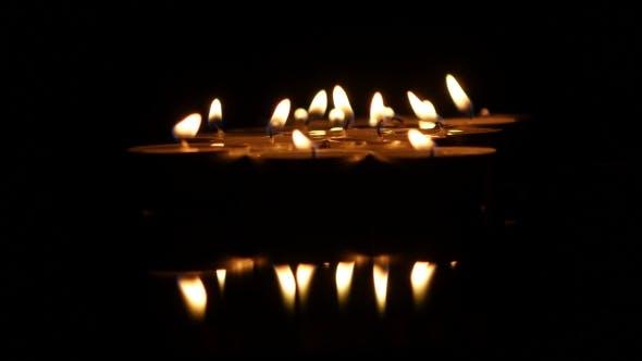 Thumbnail for Many Burning Small Candles.