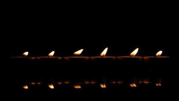Thumbnail for Six Candles On a Black Reflecting Background.