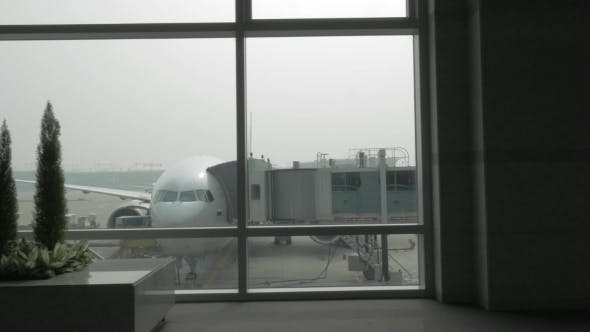 Thumbnail for Unloading The Plane With Attached Air Bridge, View From The Window