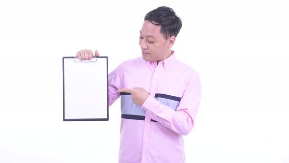 Thumbnail for Happy Japanese Businessman Showing Clipboard and Giving Thumbs Up