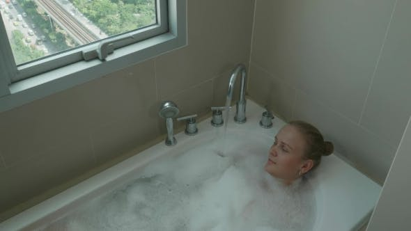 Thumbnail for Woman Taking Bath And Relaxing