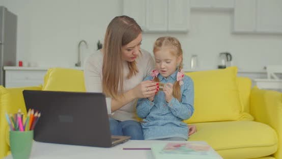 Thumbnail for Woman Giving Online Shopping Education To Daughter