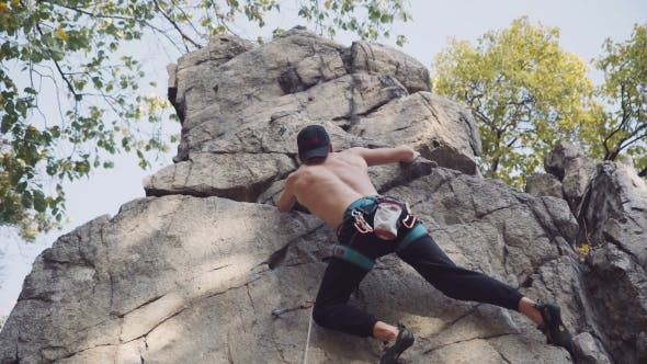 Thumbnail for Shirtless Young Man Rock Climbing