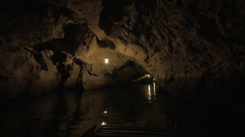 Excursion By Boat Through The Dark Cave System, Mysterious Atmosphere Of Vietnam Nature