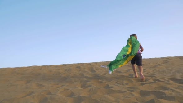 Cover Image for Child With Brazilian Flag Running On The Sand