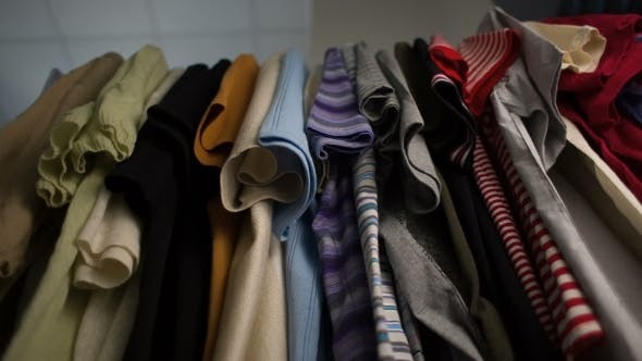 Thumbnail for Men's T-shirts On Hangers At Wardrobe