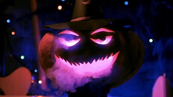 Thumbnail for Big Halloween Pumpkin In The Lights And Smoke Of The Club