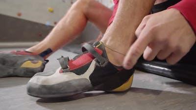 Sportsman Putting on Sneakers