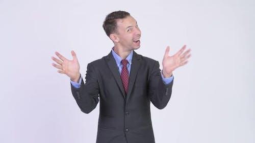 Studio Shot of Happy Businessman with Surprise Gesture