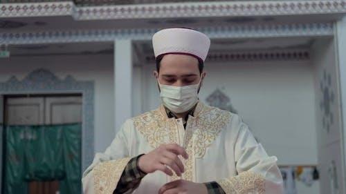 Masked Muslim İmam Praying in Mosque