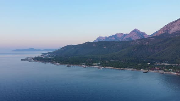 Cover Image for Aerial Viev Shore Near Mountains At Dawn