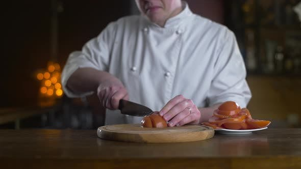 Thumbnail for The Cook Cuts Fresh Red Tomatoes on the Wooden Board in a Bar in Slow Motion, Cooking Fresh Vgetable