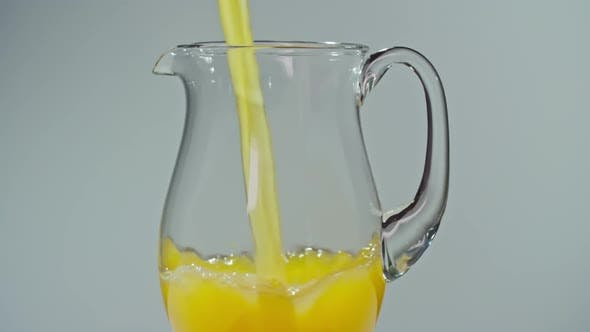 Thumbnail for Fresh Squeezed Citrus Juice Flowing in Jug