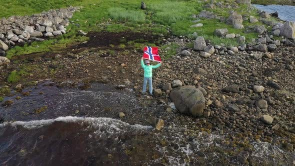 Woman with a Waving Flag of Norway