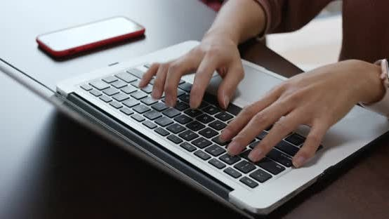 Thumbnail for Woman type on laptop computer