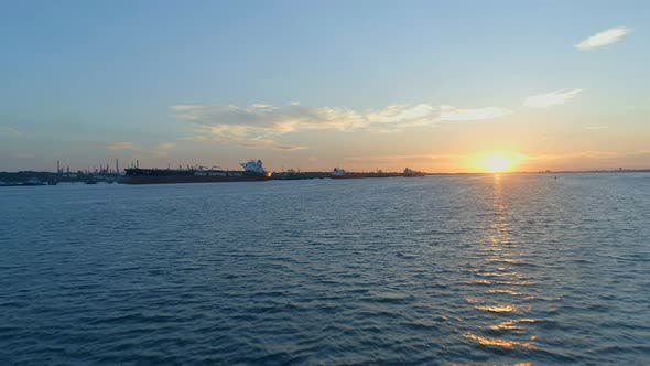 Sunset Over Southampton Docks With Ships Being Loaded With Cargo