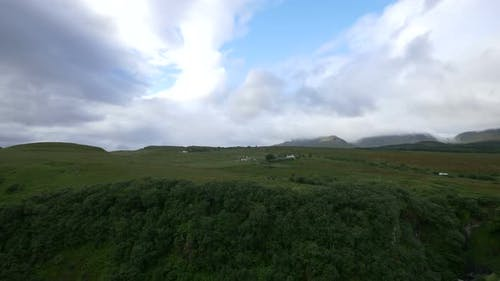 Panoramic view a green valley in Scotland