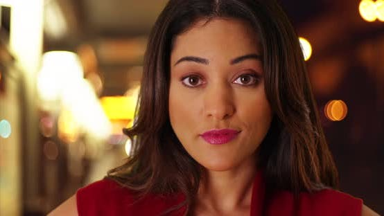 Thumbnail for Close up of beautiful Latina female looking at camera with calm expression