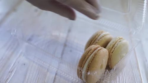 Hands of Chef Making Macaroons. Laying Out Ready Macaron