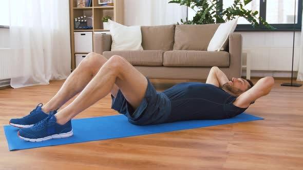 Thumbnail for Man Making Abdominal Exercises at Home