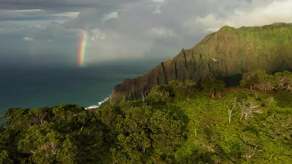 Thumbnail for Hawaii. View From Behind the Coastal Mountains To the Ocean with Bright Rainbow Over the Water.