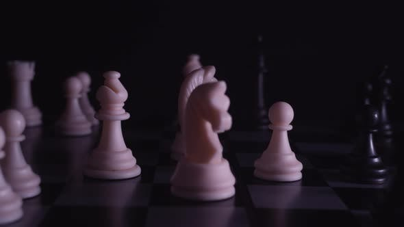 Thumbnail for Chess pieces on a chessboard in a neon style