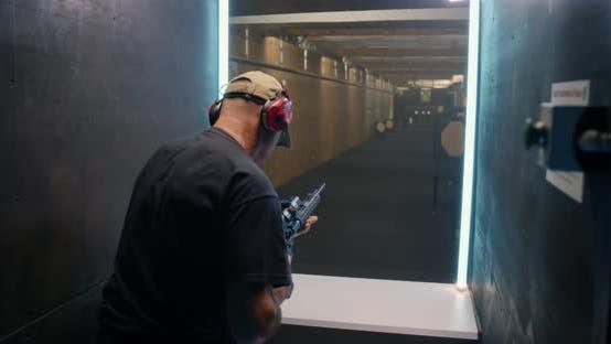 Professional Shooter Firing at Target