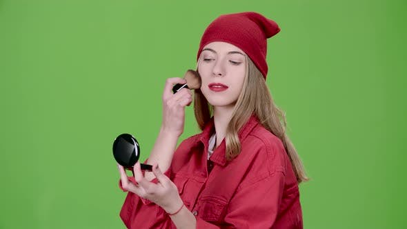 Thumbnail for Girl Is Applying Makeup with a Brush, Green Screen, Slow Motion