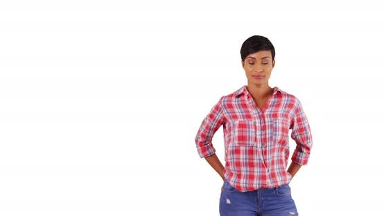 Thumbnail for Portrait of casually dressed black female smiling at camera on white background