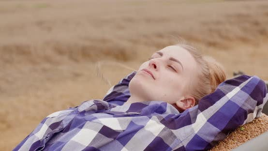 Cover Image for Successful Female Farmer Relaxing at Farm