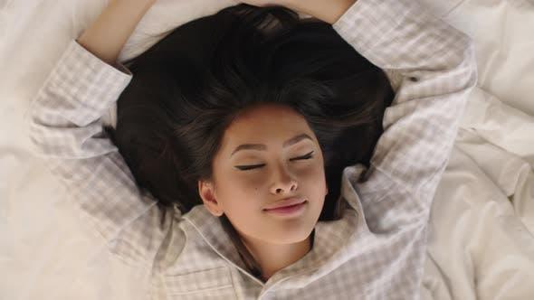 Thumbnail for Asian Woman Waking Up