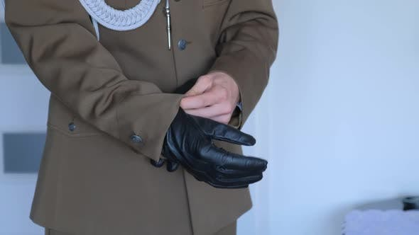 Thumbnail for Military Groom Is Putting on Leather Gloves.