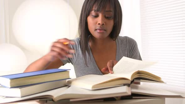 Thumbnail for African woman reading and taking notes