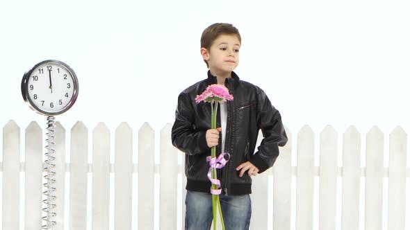 Thumbnail for Little Boy with Flowers Is Waiting for His Girlfriend, She Is Delayed. White Background
