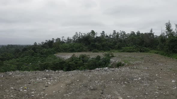 Aerial footage of a garbage landfill, showing the trash piled up