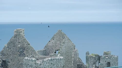 Ruins Of Medieval Dunluce Castle With The Beautiful Bright Blue Sky In Antrim, Northern Ireland, Uni