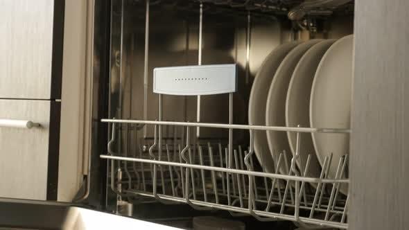 Thumbnail for Closing of  dishwasher panel doors  4K 2160p 30fps UltraHD footage - Dishwashing machine drawer clos