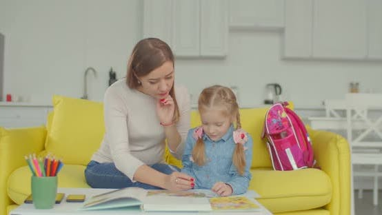 Thumbnail for Mom Teaching Schoolgirl To Solve Mathematic Example