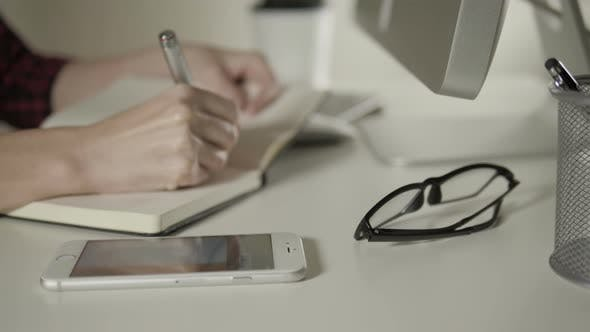 Thumbnail for Accountant Calculating On Smartphone In Office