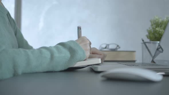 Thumbnail for Girl Use Laptop And Writing Notes