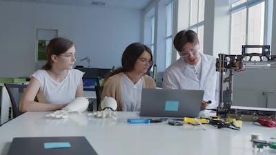 Teacher Explains the Work of 3D Printed Machine
