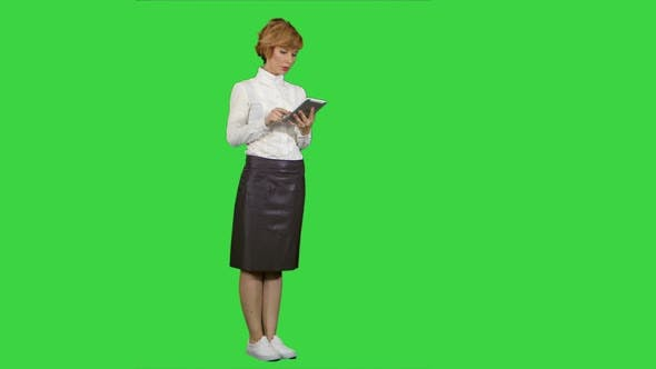 Thumbnail for Pretty Young Woman Using Tablet on a Green Screen, Chroma Key