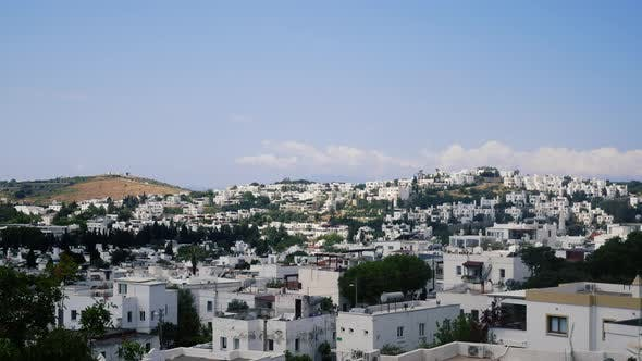 Thumbnail for Time Lapse of the Resort Town of Bodrum, Turkey. White Houses and Mills in the Blue Sky