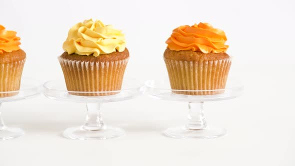 Thumbnail for Cupcakes with Frosting on Confectionery Stands