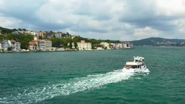 Thumbnail for Istanbul Bosphorus Waterside House And Boat Passing Aerial View 2