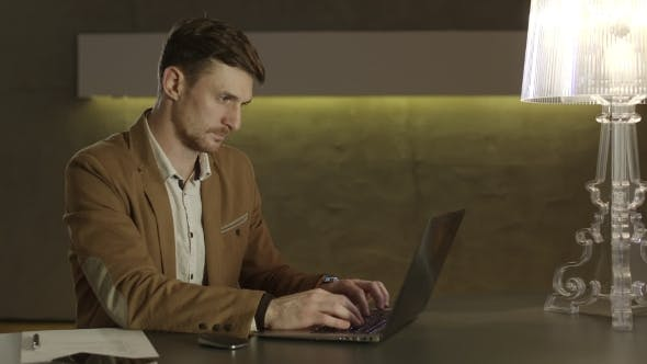 Thumbnail for Businessman Concentrated On Work With His Laptop Computer.