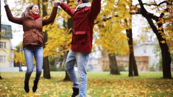 Thumbnail for Happy Young Couple Having Fun In Autumn Park 19